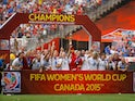 The United States poses for pictures with the World Cup Trophy after their 5-2 win over Japan in the FIFA Women's World Cup Canada 2015 Final at BC Place Stadium on July 5, 2015