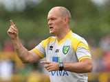 Alex Neil, the Norwich City manager, issues instructions during the pre season friendly match between Hitchin Town and Norwich City at Top Field Stadium on July 14, 2015
