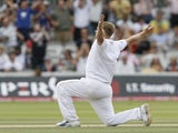 England's Andrew Flintoff celebrates after bowling Australia's Peter Siddle (not pictured) and gets five wickets on his final Ashes match at Lords during the Australian second Innings on the final day of the second Ashes Test match at Lord's cricket groun