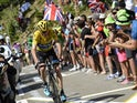 Great Britain's Chris Froome rides in the hill as supporters cheer during the 167 km tenth stage of the 102nd edition of the Tour de France cycling race on July 14, 2015