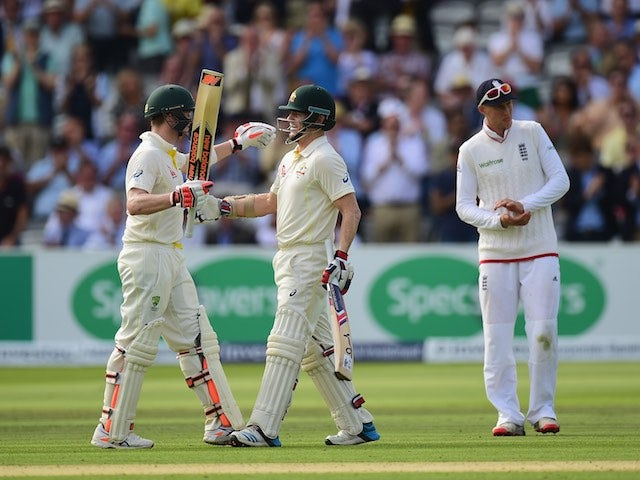 Chris Rogers of Australia celebrates his century with teammate Steven Smith during day one of the second Ashes Test at Lord's on July 16, 2015