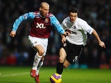Freddie Ljungberg (L) of West Ham United is challenged by Simon Davies (R) of Fulham during the Barclays Premier League match between West Ham United and Fulham at Upton Park on January 12, 2008