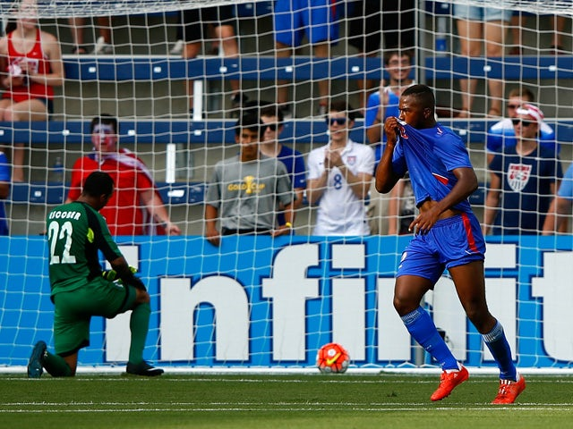 Nazon Duckens #20 of Haiti celebrates after scoring a goal against goalkeeper Donis Escober #22 of Honduras during the 2015 CONCACAF Gold Cup match at Sporting Park on July 13, 2015