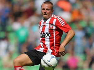 Jordy Clasie of FC Southampton runs with the ball during the friendly match between FC Groningen and FC Southampton at Euroborg Arena on July 18, 2015