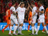 James Milner (C) of Liverpool celebrates his goal with teammates during the friendly football match between English Premier League side Liverpool and A-League side Brisbane Roar at Suncorp Stadium in Brisbane on July 17, 2015