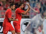 Liverpool football player Lazar Markovic celebrates with his team after scoring against the Thailand All Stars at Rajamangala stadium in Bangkok on July 14, 2015