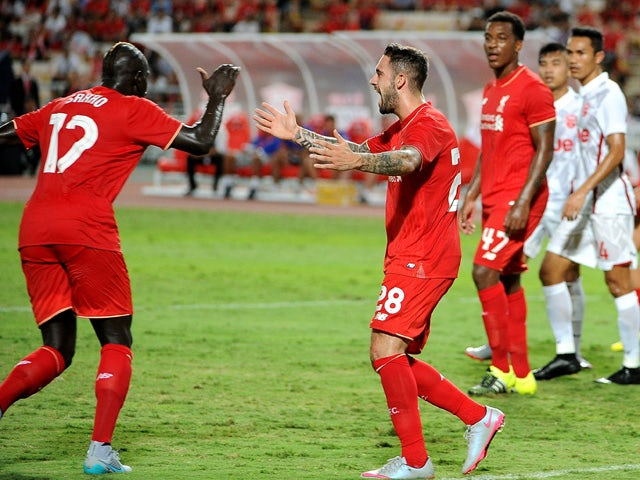 Mamadou Sakho of Liverpool (L) celebrates his goal during the international friendly match between Thai Premier League All Stars and Liverpool FC at Rajamangala Stadium on July 14, 2015