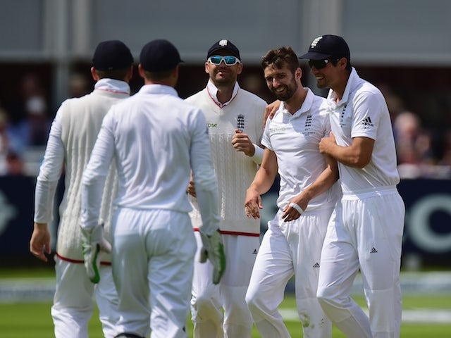 England players celebrate Mark Wood taking a wicket on day two of the second Ashes Test at Lord's on July 17, 2015