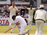 Australia's Mitchell Marsh (L) celebrates bowling out Englands Captain Alastair Cook (down) on the third day of the second Ashes cricket test match between England and Australia at Lord's cricket ground in London, on July 18, 2015