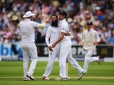 England celebrate after Moeen Ali took the first wicket of the second Ashes Test against Australia at Lord's on July 16, 2015