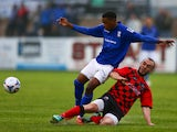 Reece Brown of Birmingham City is challenged by Shane Byrne of Nuneaton Town during the pre season friendly match between Nuneaton Town and Birmingham City at the James Parnell Stadium on July 14, 2015