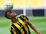 Manchester Uniteds international striker Dutch Robin Van Persie juggles with the ball after signing a contract with the Turkish Super Lig giants football club Fenerbahce at the Sukru Saracoglu stadium in Istanbul on July 14, 2015