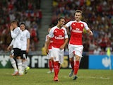 Arsenal players celebrate their second goal scored by Santi Cazorla during the Barclays Asia Trophy match between Arsenal and Everton at the National Stadium on July 18, 2015