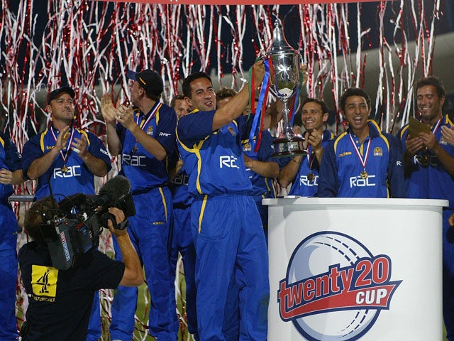 Adam Hollioake, the Surrey captain, and the rest of the team celebrate with the trophy after the Surrey v Warwickshire Final of the Twenty20 competition at Trent Bridge on July 19, 2003