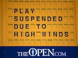 A sign at St Andrews signals the suspension of play in The Open