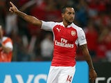 Theo Walcott of Arsenal celebrates after scoring against Everton during the Barclays Asia Trophy final match between Arsenal and Everton at the National Stadium on July 18, 2015