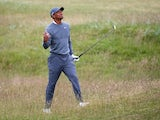 Tiger Woods plays a shot during the first round of The 144th Open at St Andrews on July 16, 2015