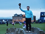 Tom Watson waves to the crowd as he plays his last ever hole in The Open at St Andrews on July 17, 2015