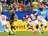 Trinidad and Tobago's Keron Cummings (C) celebrates scoring against Mexico during a CONCACAF Gold Cup Group C match in Charlotte, North Carolina, on July 15, 2015.