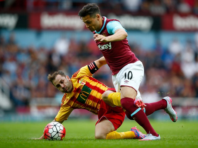 Mauro Zarate of West Ham is challenged by Paul French of FC Birkirkara during the UEFA Europa League second qualifying round (first leg) match between West Ham and FC Birkirkara at the Boleyn Ground on July 16, 2015