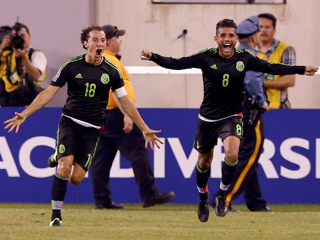 Andres Guardado #18 of Mexico celebrates his goal with teammate Jonathan do Santos #8 in the final minute of overtime against Costa Rica during the quarterfinals of the 2015 CONCACAF Gold Cup at MetLife Stadium on July 19, 2015