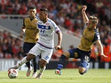Lyon's French midfielder Corentin Tolisso vies with Arsenals Welsh midfielder Aaron Ramsey during the pre-season friendly football match between Arsenal and Lyon at The Emirates Stadium in north London on July 25, 2015