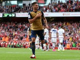 Olivier Giroud of Arsenal celebrates after scoring the first goal during the Emirates Cup match between Arsenal and Olympique Lyonnais at the Emirates Stadium on July 25, 2015