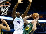 Gordon Hayward #20 of the Utah Jazz drives to the basket against Bismack Biyombo #8 of the Charlotte Hornets during their game at Time Warner Cable Arena on December 20, 2014