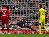 Villarreal's midfielder Bruno Soriano (R) scores this penalty pastLyons goalkeeper Mathieu Gorgelin during the pre-season friendly football match between Lyon and Villarreal at The Emirates Stadium in north London on July 26, 2015