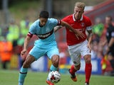 Kyle Knoyle of West Ham United holds off the challenge of Chris Solly of Charlton Athletic during the pre season friendly match between Charlton Athletic and West Ham United at the Valley on July 25, 2015