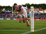 Charly Runciman of the Dragons dives to score during the round 18 NRL match between the Cronulla Sharks and the St George Illawarra Dragons at Remondis Stadium on July 12, 2015