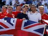 Britain's Andy Murray celebrates with the Davis Cup team after beating France's Gilles Simon in a Davis Cup world group quarter-finals singles tennis match at the Queen's Club in west London on July 19, 2015