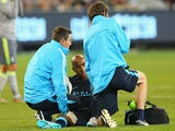 Fabian Delph of Manchester City is attended to by trainers during the International Champions Cup match between Real Madrid and Manchester City at Melbourne Cricket Ground on July 24, 2015