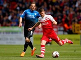 Johann Gudmundsson of Charlton and Dan Gosling of Bournemouth during the Sky Bet Championship match between Charlton Athletic and AFC Bournemouth at The Valley on May 2, 2015