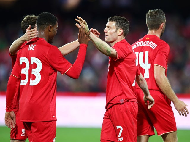 James Milner (R) of Liverpool celebrates with Jordon Ibe (L) after scoring the first goal during the international friendly match between Adelaide United and Liverpool FC at Adelaide Oval on July 20, 2015