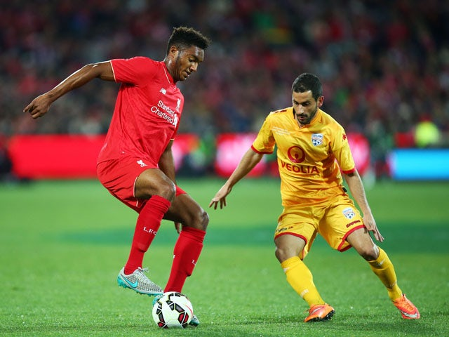 Joe Gomez of Liverpool is challenged by Sergio Cirio of United during the international friendly match between Adelaide United and Liverpool FC at Adelaide Oval on July 20, 2015