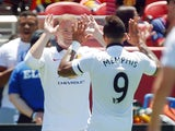 Wayne Rooney #10 of Manchester United high fives Memphis Depay #9 after scoring against Barcelona in the eighth minute during the International Champions Cup on July 25, 2015
