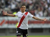River Plate's midfielder Manuel Lanzini celebrates after scoring the team's second goal against Independiente during their Argentine First Division football match, at the Monumental stadium in Buenos Aires, Argentina, on June 9, 2013