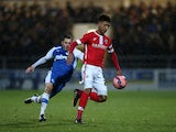 Mason Holgate of Barnsley clears the ball from Craig Mahon of Chester during the FA Cup Second Round Replay match between Chester City and Barnsley at Deva Stadium on December 16, 2014