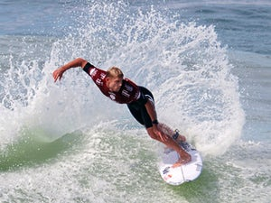 Australian surfer Mick Fanning competes against Hawaiian Dusty Payne during round 3 of the League of Surfing Professionals' Men's 2015 WSL World Championship Tour at Barra da Tijuca beach, in Rio de Janeiro, Brazil, on May 15, 2015