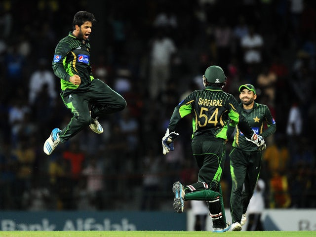 Pakistan cricketer Imad Wasim (L) and teammates celebrate after dismissing Sri Lankan cricketer Dinesh Chandimal during the third one day international (ODI) cricket match between Sri Lanka and Pakistan at the R. Premadasa International Cricket Stadium in