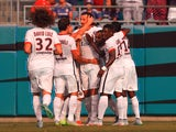 Teammates celebrate with Zlatan Ibrahimovic #10 of Paris Saint-Germain after his first half goal against Chelsea during their International Champions Cup match at Bank of America Stadium on July 25, 2015