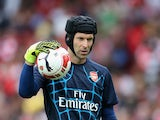 Petr Cech, the Arsenal goalkeeper warms up prior to the Emirates Cup match between Arsenal and Olympique Lyonnais at the Emirates Stadium on July 25, 2015