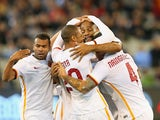 Adem Ljajic of AS Roma is congratulated by team mates after scoring a goal during the International Champions Cup friendly match between Manchester City and AS Roma at the Melbourne Cricket Ground on July 21, 2015