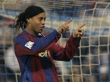 Barcelona's Brazilian Ronaldinho celebrtes his goal against Zaragoza during their Spanish league football match at Romareda Stadium in Zaragoza on February 16, 2008