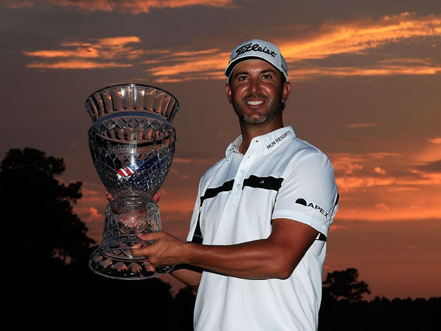Scott Piercy of the United States poses with the trophy after winning the Barbasol Championship at the Robert Trent Jones Golf Trail at Grand National Lake Course on July 19, 2015