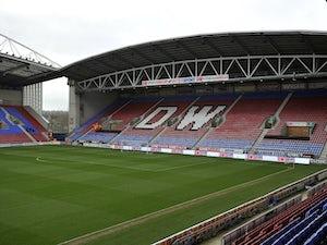 Wigan snap up midfielder Josh Laurent