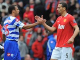 Queens Park Rangers English defender Anton Ferdinand (2-L) shakes hands with brother Manchester United's English defender Rio Ferdinand (R) after the English Premier League football match between Manchester United and Queens Park Rangers at Old Trafford i