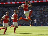 Arsenal's English midfielder Alex Oxlade-Chamberlain celebrates scoring the opening goal of the FA Community Shield football match between Arsenal and Chelsea at Wembley Stadium in north London on August 2, 2015