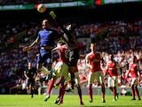 John Terry of Chelsea and Petr Cech of Arsenal compete for the ball during the FA Community Shield match between Chelsea and Arsenal at Wembley Stadium on August 2, 2015